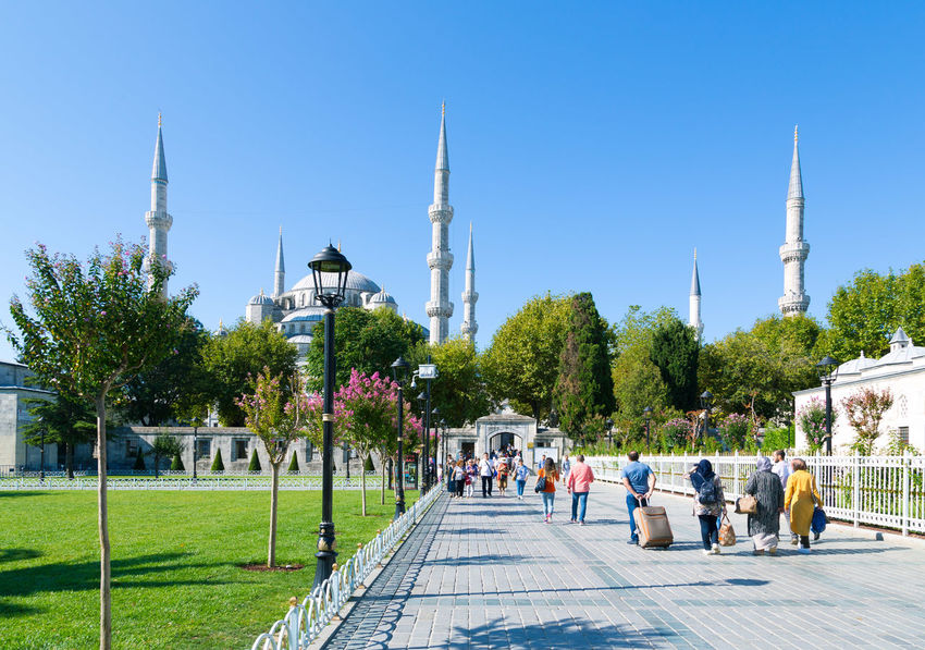 2017-09-02, Istanbul, Turkey: Tourists and pilgrims walking towards Sultan Ahmed Mosque or Blue Mosque on a sunny day during Kurban Bayram. Architecture Blue Mosque Istanbul Life In Istanbul Middle East Ramadan  Sultan Ahmed Mosque Summertime Turkey Architecture Bayram Building Exterior Built Structure Dome Islam Kurban Bayramı Men Muslim Outdoors Place Of Worship Real People Religion Summer Travel Destinations Turkish