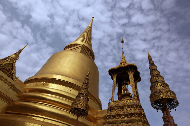 Architecture Building Exterior Built Structure Cloud Cloud - Sky Cloudy Cultures Day Design Gold Colored History Low Angle View Outdoors Pattern Place Of Worship Religion Sky Spirituality Temple - Building
