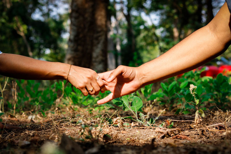 Cropped image of people female friends holding hands