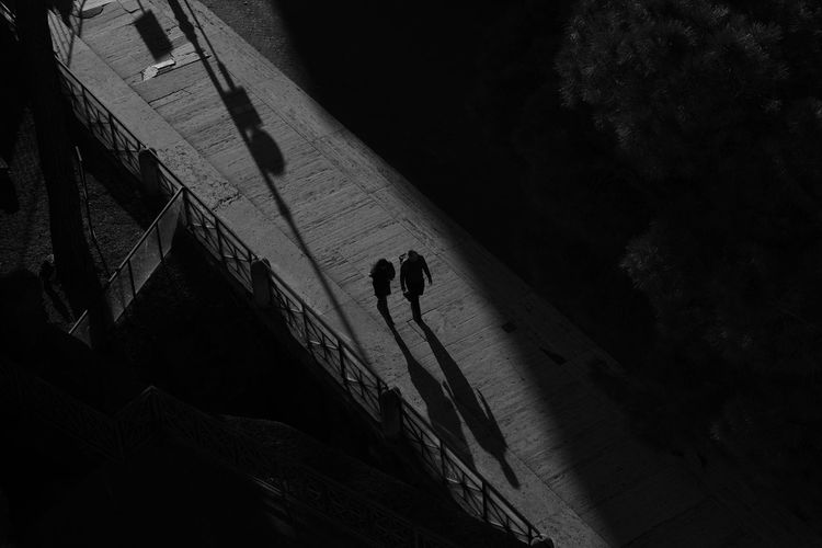 17.62° Blackandwhite Black And White Real People Diagonal Shadow LINE Streetphotography Man Woman Dark Day Contrast Eternity City Sun Sunlight Leisure Activity Silhouette Architecture High Angle View Unrecognizable Person Walking Built Structure Outdoors