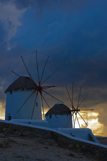 Windmills on Mykonos at sunset Greek Islands Mykonos,Greece Architecture Beach Blue Built Structure Cloud - Sky Day Greece Mykonos Nature No People Outdoors Sea Sky Sunset Water Windmill