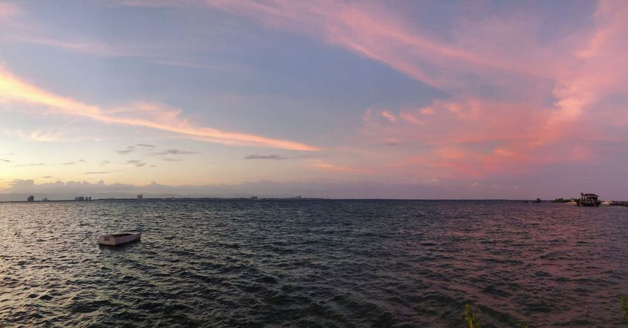 Pink skies Sea Water Sunset Scenics Beauty In Nature Tranquil Scene Tranquility Sky Horizon Over Water Cloud - Sky Nature Outdoors Nautical Vessel No People Beach Rippled Day