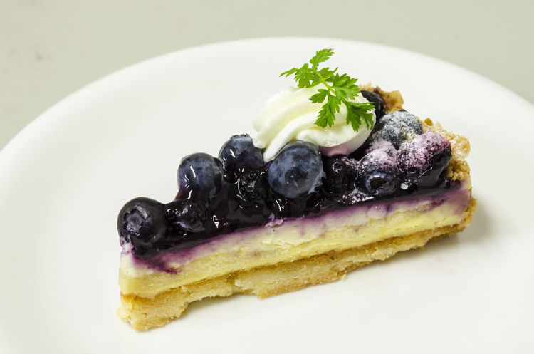 Delicious Blueberry Cheese Pie Blueberry Blueberry Cheesecake Blueberry Pie Blueberrycheesecake Close-up Dessert Food Food And Drink Freshness Gourmet Indoors  Indulgence No People Plate Ready-to-eat SLICE Still Life Studio Shot Sweet Food Temptation White Background