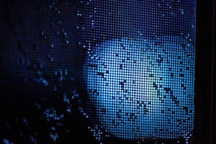 Close-up of illuminated mobile phone at night