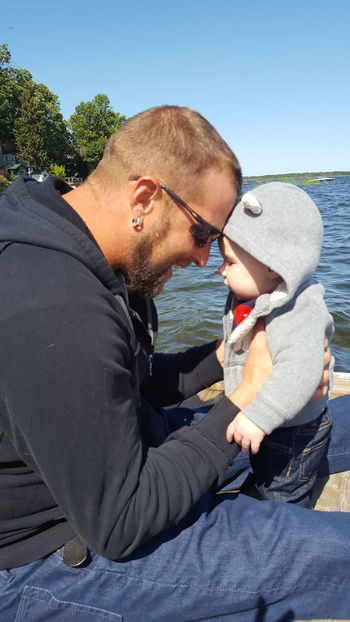 EyeEm Selects Father & Son Father And Son Fatherhood  Love Special Moments Adult Baby Baby Boy Man Sweater Weather Day Outdoors On The Lake Water Blue Sky Sunglasses Face To Face