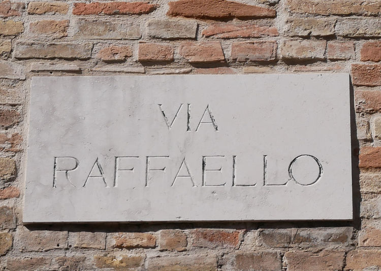 Close-up of text on brick wall