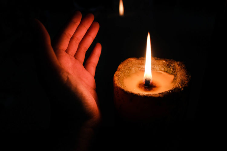 Candle in the dark Indoors  Candle Black Background Holding Finger Night Dark Close-up Illuminated Hand Fire - Natural Phenomenon Heat - Temperature Fire Burning