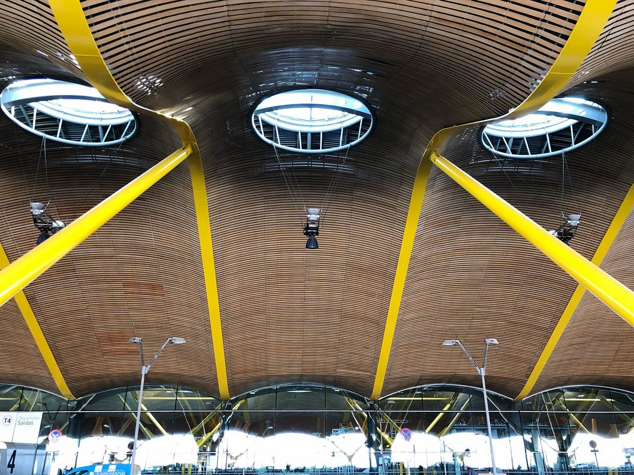 architecture, built structure, indoors, ceiling, illuminated, yellow, hanging, transportation, lighting equipment, no people, modern, metal, day, connection, roof, light, building