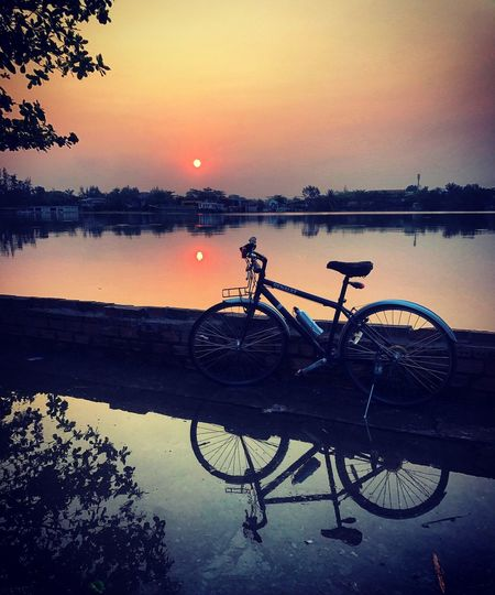 Good Morning ❤️❤️❤️ Shadow Bicycle Sunrise Water Sky Sunset Bicycle Transportation Reflection Mode Of Transportation Nature No People Outdoors Lake