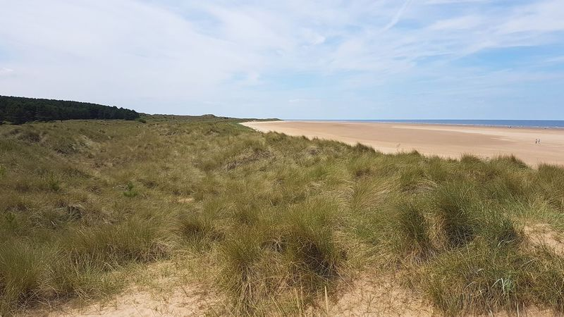 Beach Sand Sand Dune Sea Nature Landscape Sky Outdoors Cloud - Sky Scenics Tranquility Marram Grass Beauty In Nature No People Horizon Over Water Water Sun Norfolk Holkham Beach Holkham Outdoor Pursuit Tranquility Nature Growth Tranquil Scene