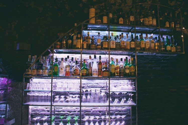 Drinks On Illuminated Shelf