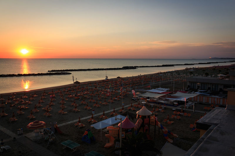 The morning on the beach of Torre Pedrera at Rimini in Italy Water Sky Sea Sunset High Angle View Architecture Scenics - Nature Horizon Over Water Nature Beauty In Nature Horizon Beach Land Orange Color Cloud - Sky Built Structure Building Exterior Roof Dusk No People Outdoors Sunrise Morning Seaside Resort Torre Pedrera