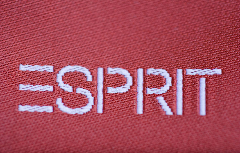 Corporate sign of a fashion company - Esprit Logo Brand Brocade Business Capital Letter Character Close-up Clothing Company Corporate Cotton Embroidery Esprit Fabric Fashion Letter Logo No People Pattern Red Sign Text Trademark White Woven Writing