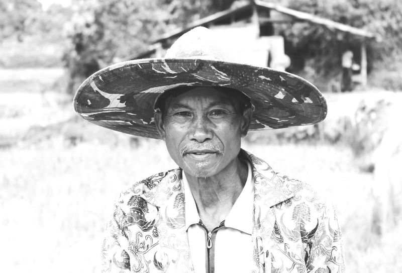 Looking At Camera Portrait Real People Outdoors Senior Adult One Person Day Smiling Happiness Close-up Adult People Asiatique Men Hat Agriculture Land Rice Field This Is Aging