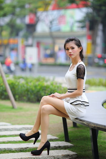 Beautiful Beautiful Woman Beauty Chinese Girl Day Fashion Focus On Foreground Full Length High Heels Lifestyles One Person One Young Woman Only Outdoor Outdoors People Portrait Real People Sitting Tree Young Adult Young Women
