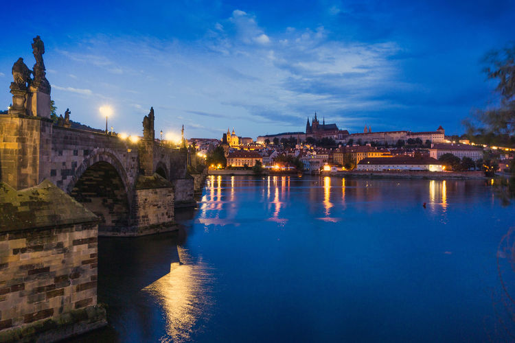 Charles bridge over river against sky during night