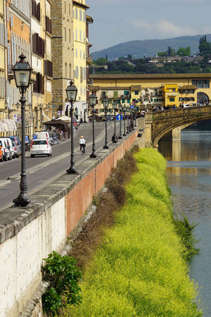 A Architecture Bridge Bridge - Man Made Structure Built Structure Canal City City Life Cityscape Cloud - Sky Day Firenze Green Lungarno Mountain Nature Outdoors Residential Building Residential District River Sky Town Travel Destinations