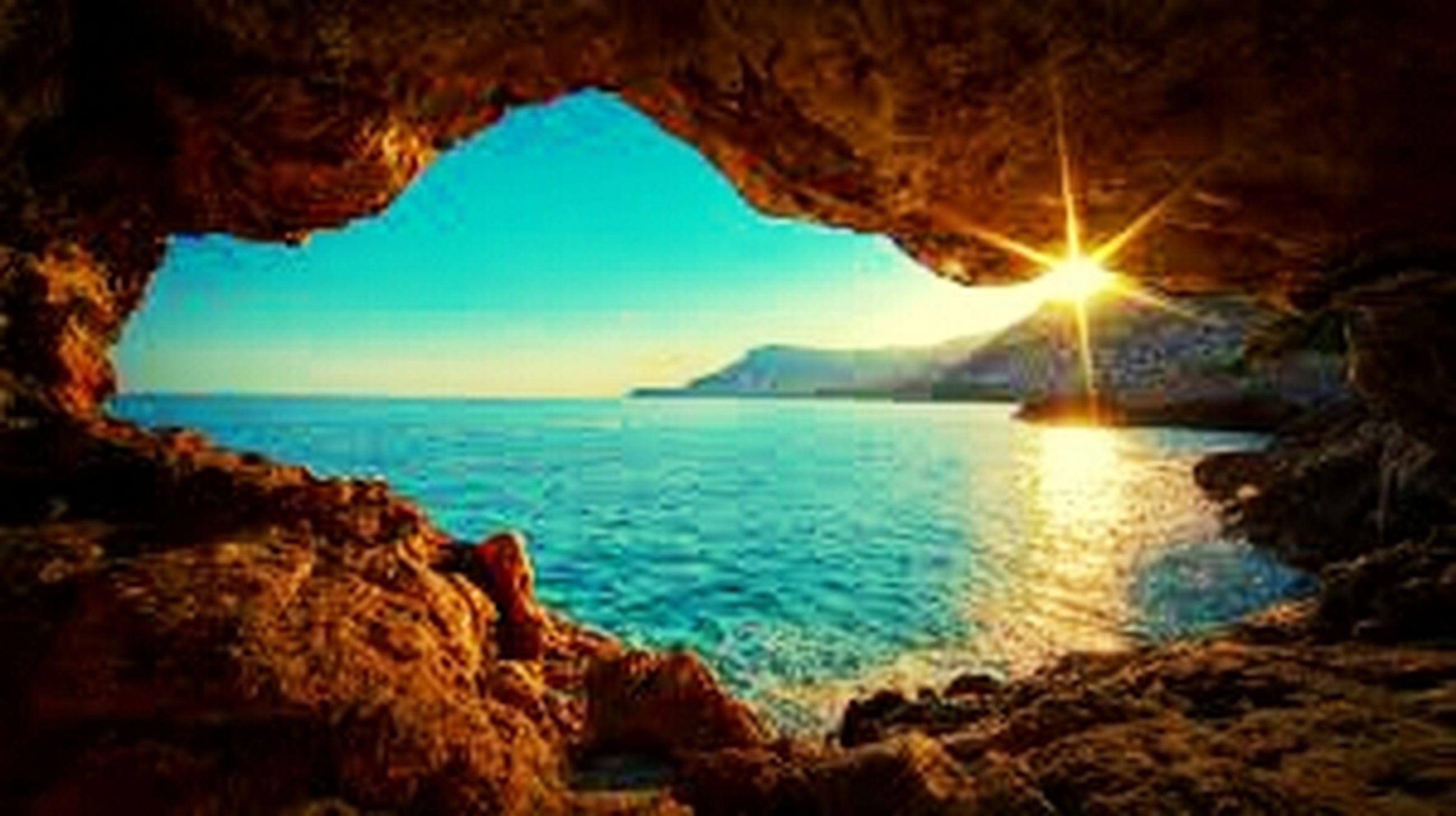 sea, water, scenics, tranquil scene, horizon over water, tranquility, beauty in nature, sun, sky, nature, rock - object, idyllic, sunlight, rock formation, beach, reflection, sunbeam, blue, mountain, shore