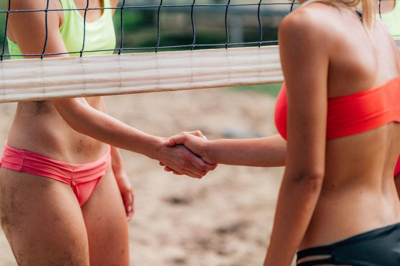 Beach volleyball girls shaking hands after the match