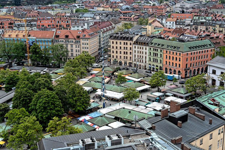 Munich, Bavaria, Germany - May 29, 2019. General aerial view of Munich from a tower, featuring the Viiktualienmarkt Munich Viktualienmarkt Market Center Germany Cityscape Aerial Square Historical Architecture View Building City Urban Europe Landmark Tower Historic Town Famous Roof Bavaria Beautiful Sky Old Travel Landscape Outdoor Day House Tourism Ancient History Street European  Top Skyline Cloudy Editorial  Bavarian Downtown Spring Summer German Building Exterior Built Structure Residential District High Angle View Outdoors TOWNSCAPE
