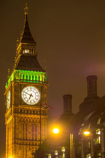 Low angle view of illuminated big ben against sky at night