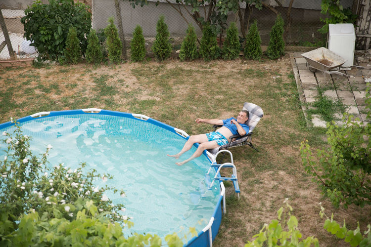 Man relaxing on poolside