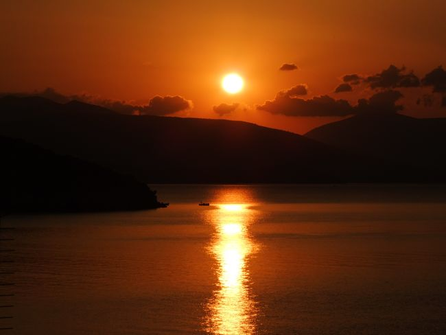 Beauty Beauty In Nature Mountain Nature No People Nofilter Orange Color Outdoors Reflection Scenics Sea Sky Sun Sunset Tranquil Scene Water