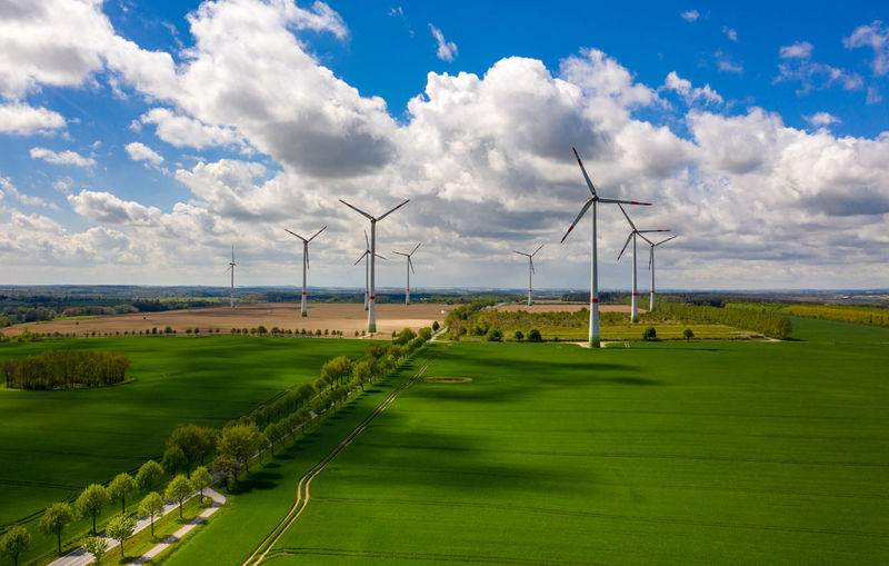 aerial view of agricultural fields with wind turbines Cloud - Sky Environment Sky Environmental Conservation Wind Turbine Turbine Landscape Grass Field Green Color Alternative Energy Fuel And Power Generation Land Renewable Energy Wind Power Day Nature No People Beauty In Nature Scenics - Nature Outdoors Sustainable Resources Aerial View Aerial Photography DJI Mavic Pro