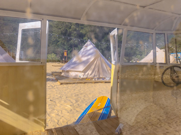 View of tent through glass window