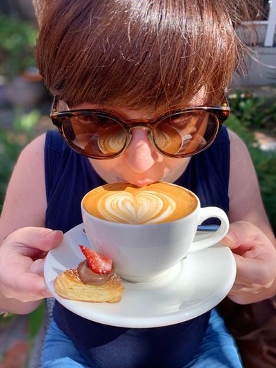 Cappuccino and a Croissant Woman Fringe Pregnant Holiday Chocolate Croissant Coffee Food And Drink Front View Glasses One Person Food Refreshment Drink Holding Adult Cup Mug Leisure Activity Lifestyles Women Coffee - Drink Day Coffee Cup Portrait Outdoors Drinking