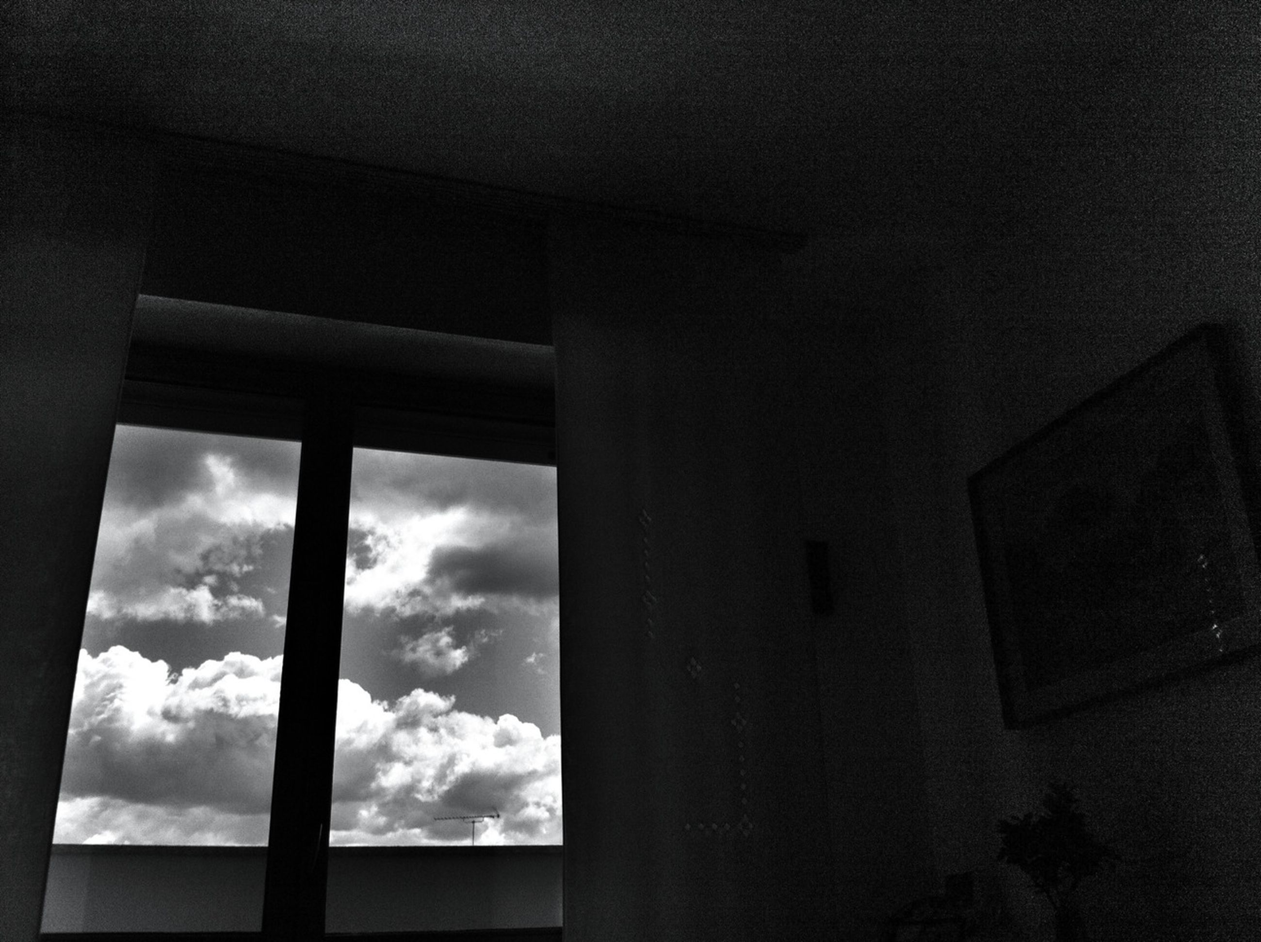 architecture, built structure, sky, window, low angle view, indoors, cloud - sky, building exterior, cloud, cloudy, day, sunlight, no people, building, silhouette, glass - material, column, architectural column, house
