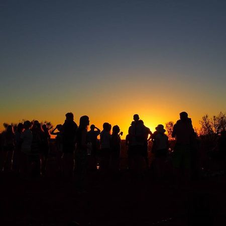 The group gathering for drinks on the last night of our tour around Ayers Rock ---------------------------------------------------------- Uluru Ayersrock Sunsets Sunsetlovers Sunset Australia Exploreaustralia Travelgram Instagram Instatravel Sunset_madness Sunrise_sunsets_aroundworld Friends Travel Wanderlust Wanderlustcontest Olympus Silouette Takemeback