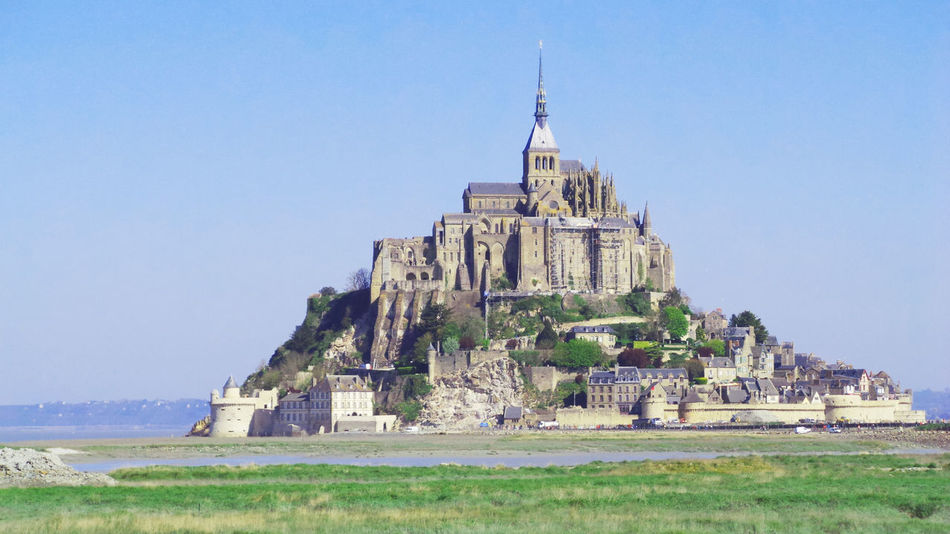 Mont Saint Michel cathedral on the island, Normandy, Northern France, Europe Field France Green Holiday Mont Saint Michel Bay Mont Saint Michel Cathedral Northern Ireland Tourist UNESCO World Heritage Site Architecture Building Exterior Built Structure Clear Sky Famous Place History Landscape Nature Normandy Outdoors Place Of Worship Religion Sea Sky Travel Destinations Water
