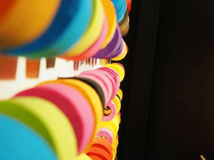 Low angle view of colorful rolls against black background