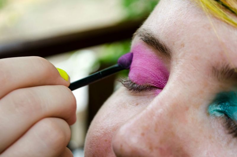Close-up of woman applying eyeshadow