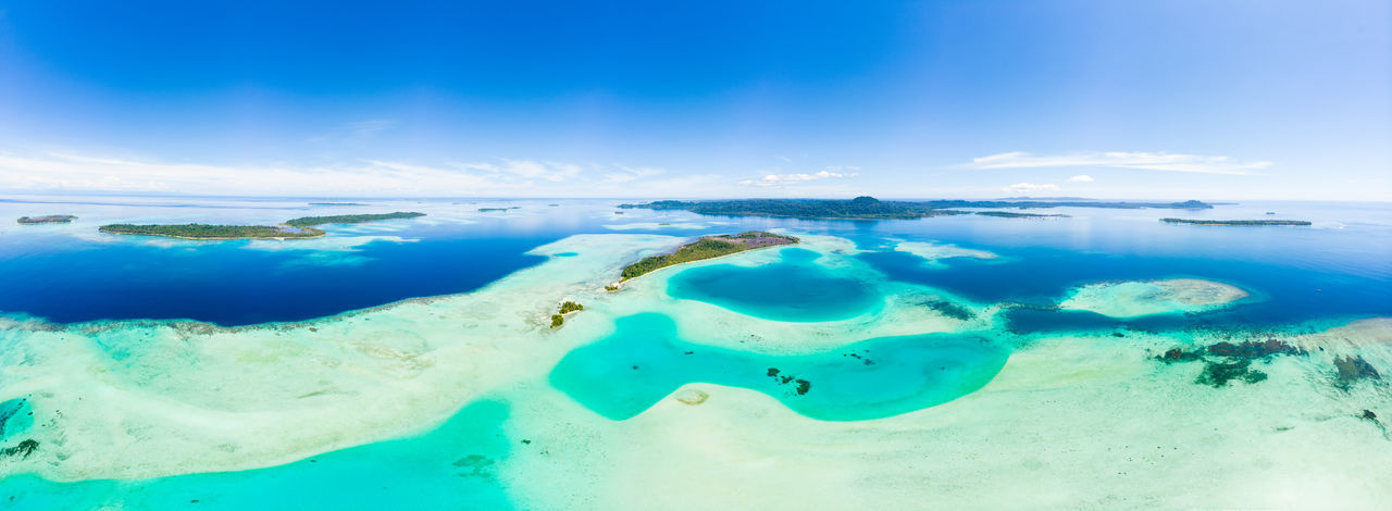 Water Sea Blue Cloud - Sky Turquoise Colored Nature Sky Underwater Scenics - Nature Land Island Tropical Climate Travel Destinations Lagoon Beauty In Nature Tranquil Scene Day Tranquility Environment No People Horizon Over Water Outdoors Tahiti