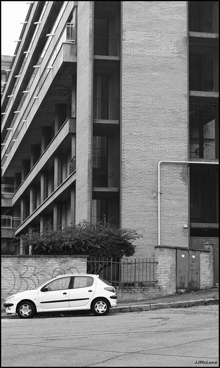 car, transportation, building exterior, built structure, architecture, mode of transport, land vehicle, stationary, day, outdoors, no people, road, city