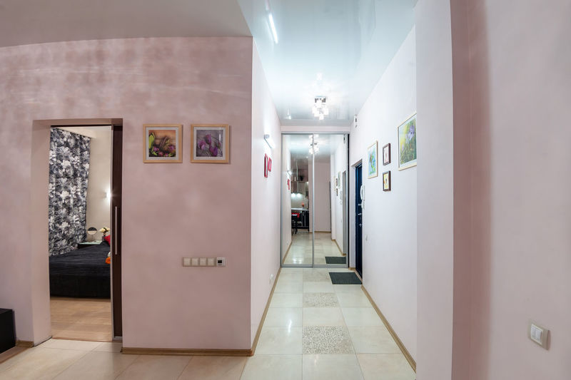 Arcade Corridor Indoors  Architecture Tiled Floor Door Flooring Illuminated Tile Entrance No People Building Empty Lighting Equipment Built Structure Wall - Building Feature Absence The Way Forward Hygiene Bathroom Ceiling