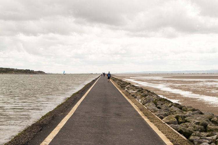 The never ending path // Cloud - Sky Outdoors Day Sky Full Length Only Men Beach The Way Forward Adult Adults Only Walking People Landscape Two People Sea Beauty In Nature Nature Salt - Mineral Waterfront Canonphotography Eom10 EyeEm Gallery Eye4photography  EyeEm Best Shots Walking Around