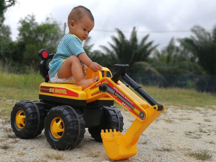 Childhood One Person People Babies Only Full Length Adventure Playing Toy Car Sports Race Capture The Moment Baby ❤ Baby Babyboy Real People Child Toy Toyphotography Toytruck Shovel Digging Shovel Boys Outdoors Day Sky Adult