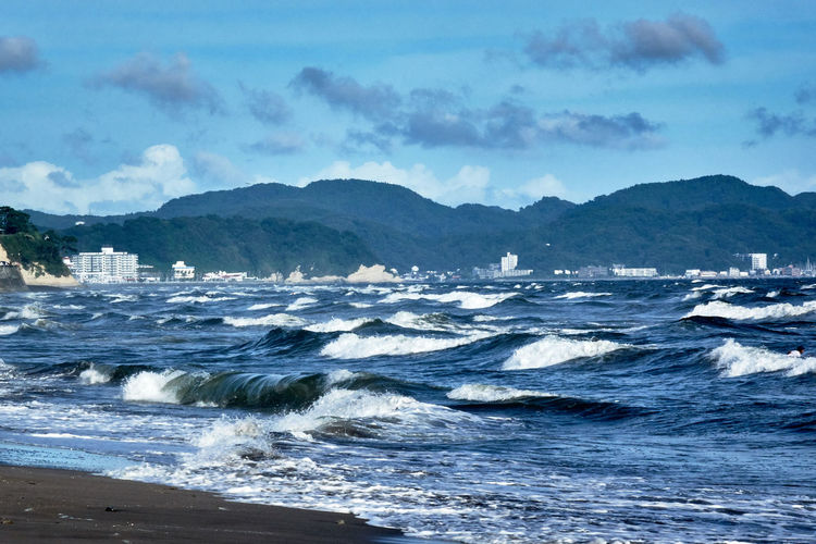 Scenic view of sea with big waves against sky