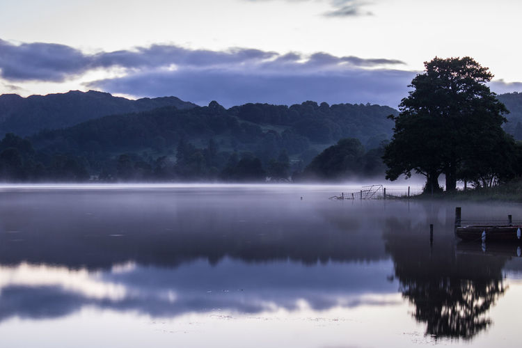 Beauty In Nature Blue Hour Calm Coniston Water Cumbria Dawn Idyllic Lake Lake District Lakeshore Landscape Mist Mountain Nature Outdoors Reflection Scenics Stillness Sunrise Tranquil Scene Tranquility Tree Water