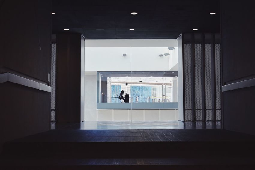 Silhouette Indoors  Architecture Built Structure Real People One Person Illuminated Lifestyles Staircase Building Leisure Activity Flooring Entrance Ceiling Wall - Building Feature