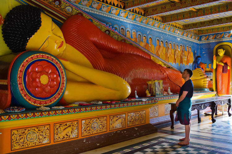 Buddha Paint The Town Yellow Peace Tranquility Buddhism Built Structure Full Length History Multi Colored One Person People Religion Spirituality Travel Destinations