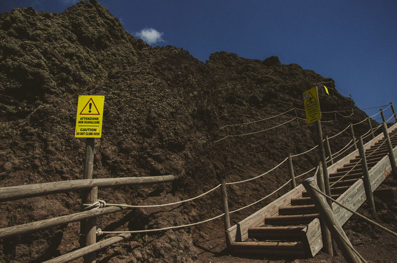 Paint The Town Yellow Danger Sign Stairs Vesuvio Beauty In Nature Day Low Angle View Mountain Nature No People Ropes Scenics Sky Volcano