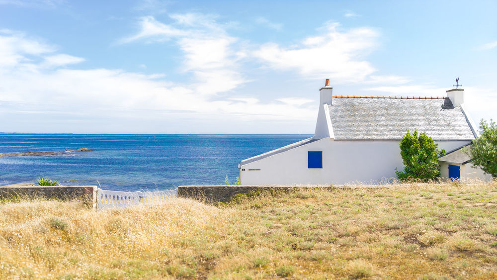 Tranquil house by the sea Architecture Building Exterior Built Structure Cloud - Sky Day Grass Horizon Over Water House House By The Sea House Over The Sea Houses And Windows No People Outdoors Plant Sea Shutter Sky Water