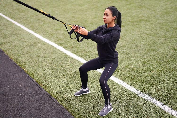 Full length of woman exercising at park