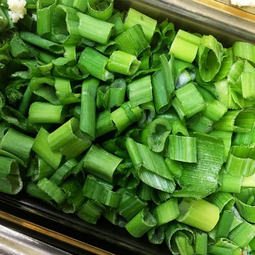 High Angle View Of Chopped Scallions On Table