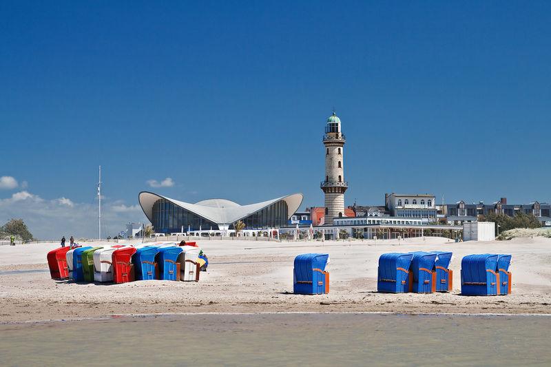 Lighthouse against blue sky at beach