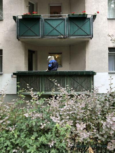 Man working on window of building
